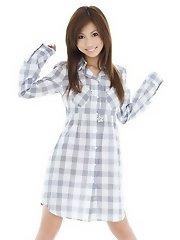 Asian teen opens her shirt