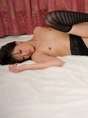 Short-haired brunette Uta Kohaku teasing with her ass and pussy while bending over