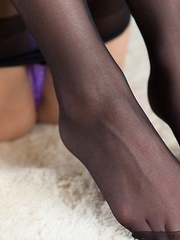 Uniformed beauty Uika Hoshikawa shows her feet in pantyhose while masturbating
